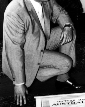 L44474 man kneeling in suit