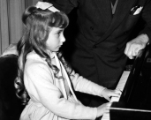 L44777 girl at piano with suit