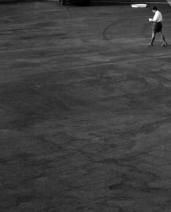 L44912 man waling across tarmac