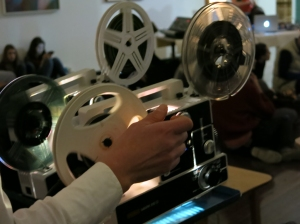 Louise Curham gently manipulates the super 8 projectors