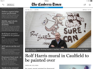 Rolf mural painted over in red paint
