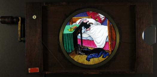 'Man Eating Rats', hand painted and copperplate printed rackwork and slipping slide, c1890s.